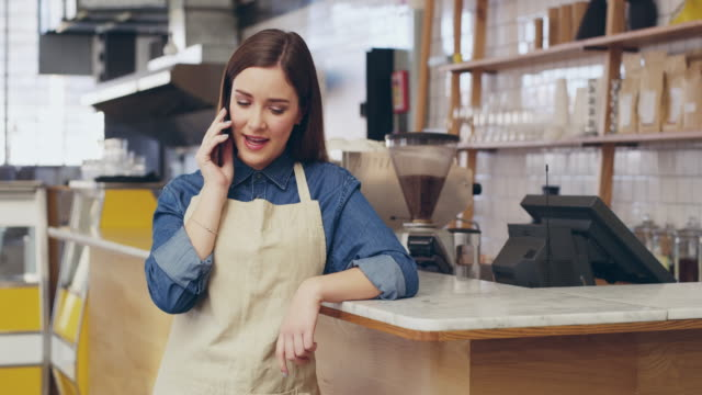 making the calls that make her cafe a success - content stock videos & royalty-free footage