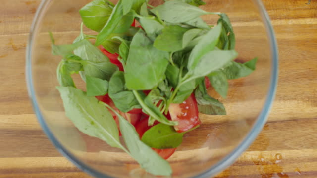 making tomato salad - basil stock videos & royalty-free footage