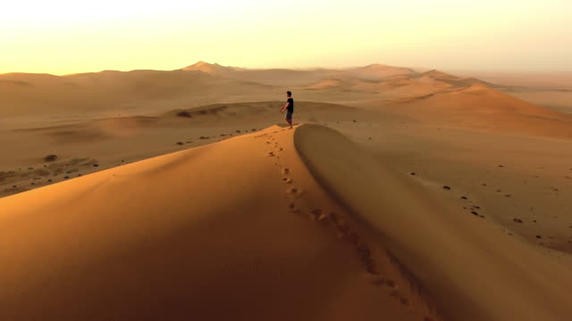making tracks over the sand dunes - one man only stock videos & royalty-free footage