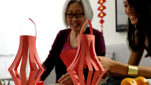 making traditional chinese new year decorations - 65 69 years stock videos & royalty-free footage