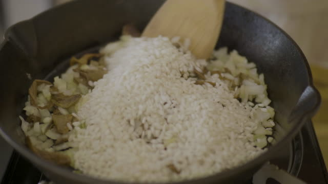 making vegan mushroom risotto - risotto stock videos & royalty-free footage