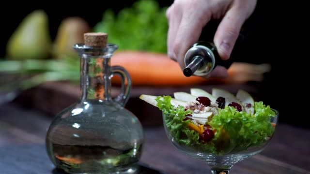 making vegan salad with carrot and pear - salad oil stock videos & royalty-free footage