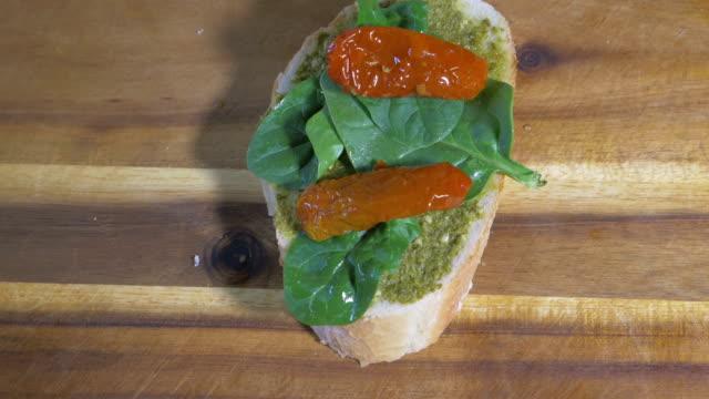 making  vegetarian bruschetta on wooden board