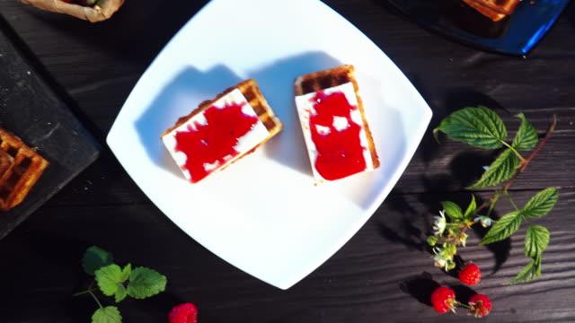 making waffles with fresh raspberries - brambleberry stock videos & royalty-free footage