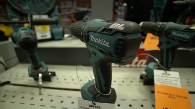 Makita brand electric drills on display at Bunnings Warehouse hardware store