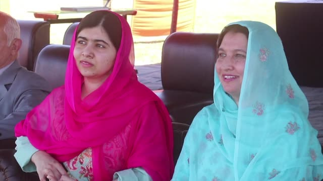 stockvideo's en b-roll-footage met malala yousafzai landed in the swat valley for her first visit back to the once militant infested pakistani region where she was shot in the head by... - clean