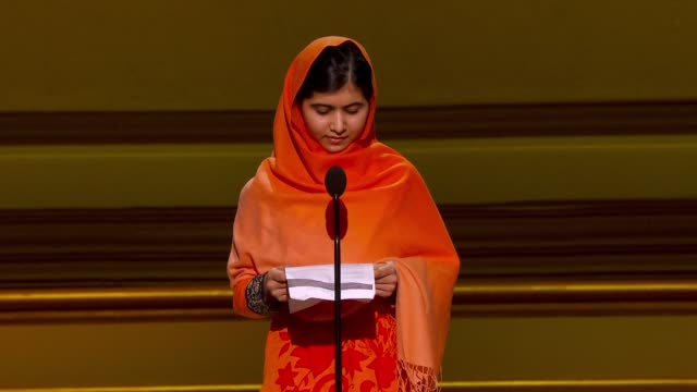 vídeos de stock, filmes e b-roll de speech malala yousafzai thanks glamour for the honor on what she believes that a gun kills but a pen can give life and that we are here to raise our... - 2013