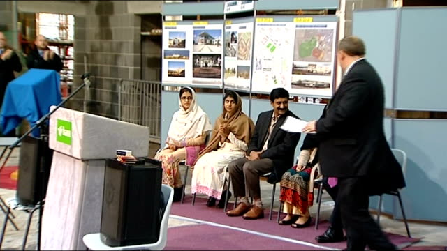 malala yousafzai visits topping out of new scottish primary school malala and friends sitting with gordon brown during speeches / malala listening... - ピーリング点の映像素材/bロール