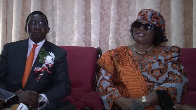vídeos de stock, filmes e b-roll de malawi's former president joyce banda returns home after four years of self-imposed exile despite facing the threat of arrest over corruption... - ex