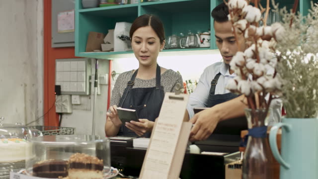 Malay business couple working at coffee shop