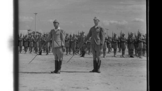 malay volunteer force soldiers demonstrate their military proficiency as imperial japanese army representatives inspect the volunteers at the former... - japanese military stock videos & royalty-free footage
