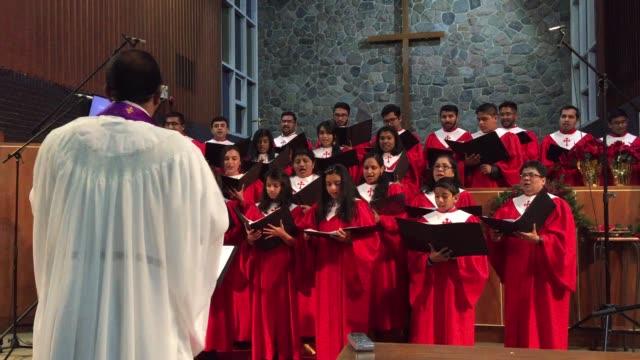 malayalee canadian catholic choir members perform christmas carols during a special church program in toronto, ontario, canada, on december 08, 2018.... - choir stock videos & royalty-free footage
