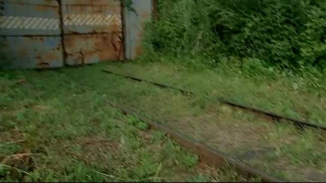 only 200 mh17 victims on train to kharkiv kharkiv grass covered tracks pan gates sun set behind railings - kharkov stock videos & royalty-free footage