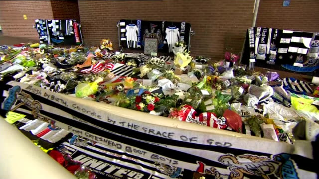 ordeal of victims' families england newcastle st james' park ext tributes of scarves and memorabilia outside football club newcastle united scarves... - neckwear stock videos and b-roll footage