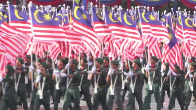 malaysia celebrates its independence day with thousands of people taking part in parades in the administrative capital of putrajaya - putrajaya stock videos & royalty-free footage