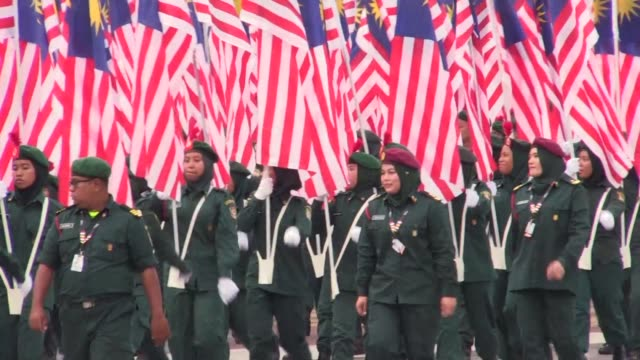 malaysia celebrates its national day as malaysian armed forces personnel march during a parade in putrajaya - putrajaya stock videos & royalty-free footage