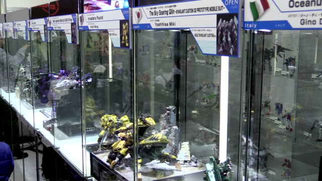 malaysian and south korean fans were the winners of an international contest to create dioramas featuring a plastic miniature of gundam, one of the... - 14 15 years stock videos & royalty-free footage