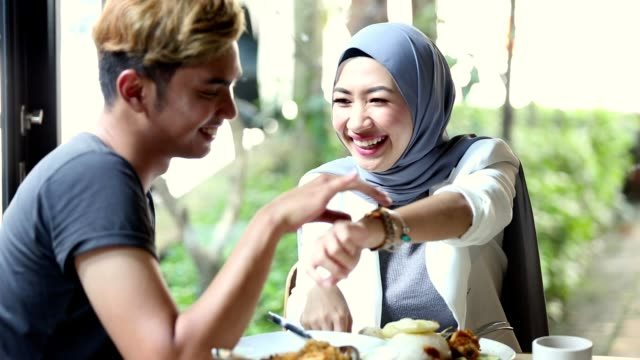 malaysian couple enjoy dining together in outdoor cafe - admiration stock videos & royalty-free footage