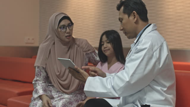 malaysian doctor explaining mother about the daughter's treatment - malay family stock videos and b-roll footage
