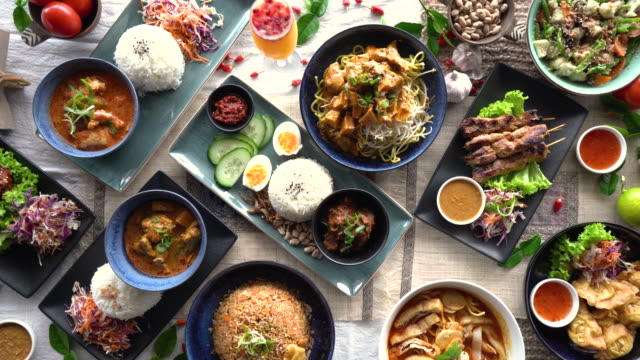 malaysian food background. - table top view stock videos & royalty-free footage