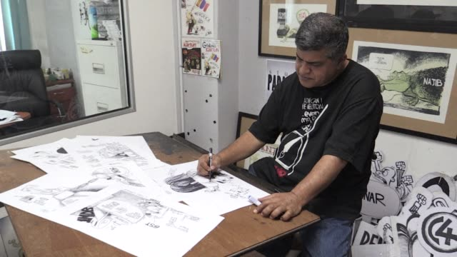malaysian political cartoonist zunar faces a possible 43 years in prison for sedition but the defiant artist says that looming threat wont stop his... - cartoonist stock videos & royalty-free footage