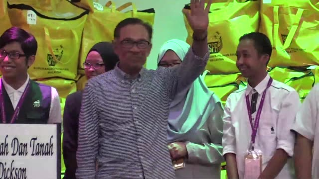 Malaysia's Anwar Ibrahim gives his first press conference after winning an overwhelming mandate in a parliamentary by election setting the stage for...