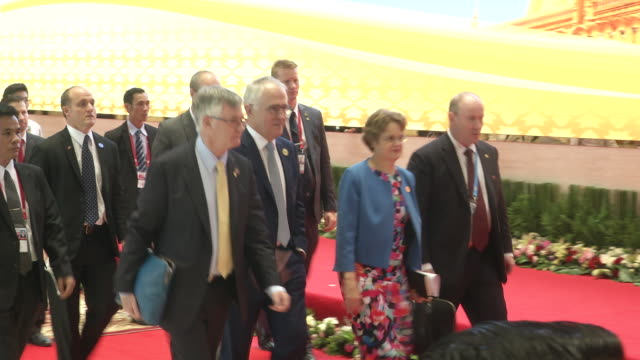 malcolm turnbull prime minister of australia and spouce walk to a meeting at the association of southeast asian nations summit the laotian capital... - association of southeast asian nations stock videos & royalty-free footage