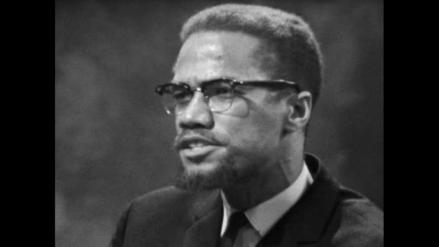 vídeos de stock e filmes b-roll de malcolm x believes the black community in the usa showing restraint during the 1964 race riots in the usa was a miracle when faced with provocation. - 1964