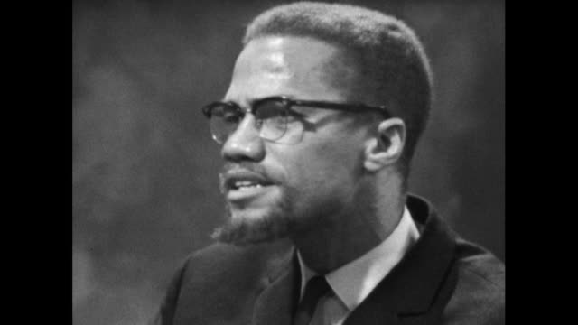 """malcolm x explains how he feels that proper education is necessary to stop hostility and racism towards black people citing """"education will do it... - editorial stock videos & royalty-free footage"""