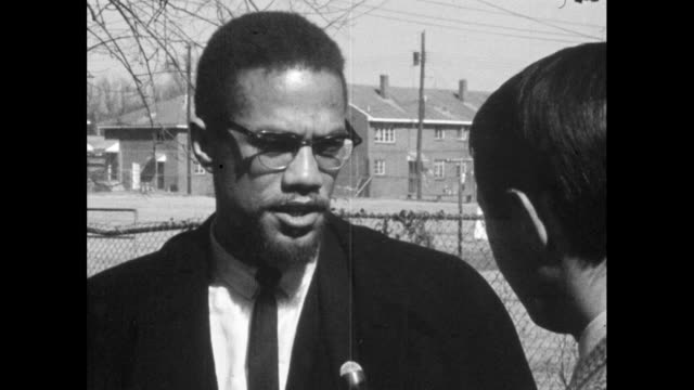 malcolm x explains how his approach to confront racial injustice and equality is in opposition to martin luther king's nonviolent approach but both... - 1965 stock videos & royalty-free footage