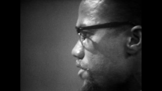 """malcolm x explains the concept of """"by any means"""" and feels even a 'bloodbath' could be justified; 1964. - extreme close up stock videos & royalty-free footage"""