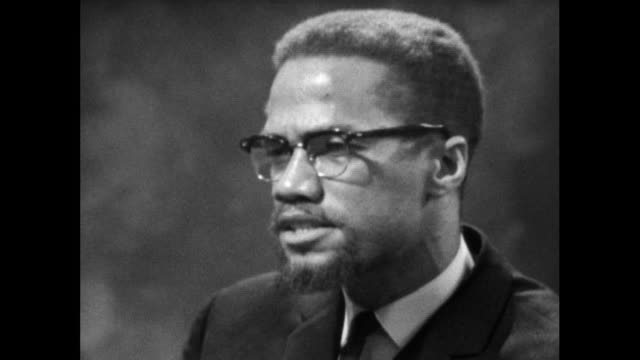 """malcolm x explains the intentions of the organisation for afro-american unity as wanting unity and equality """"by any means necessary""""; 1964. - editorial stock videos & royalty-free footage"""