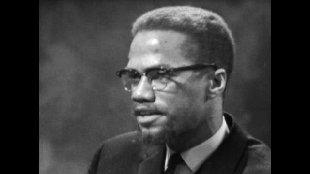 malcolm x explains the reasons for changing his name from malcolm little to malcolm x; 1964. - identity stock videos & royalty-free footage