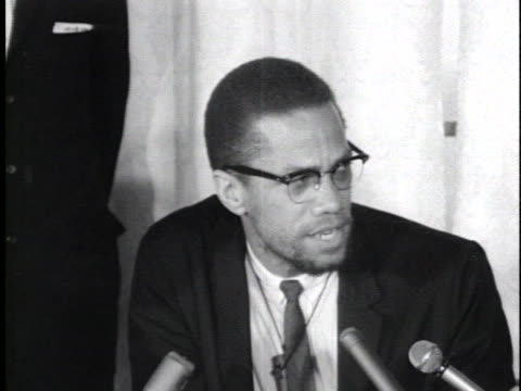 stockvideo's en b-roll-footage met malcolm x praises the kenyan mau mau terrorist group; malcolm x blasts the us for its white supremacist attitude; malcolm x encourages americans to... - war or terrorism or military