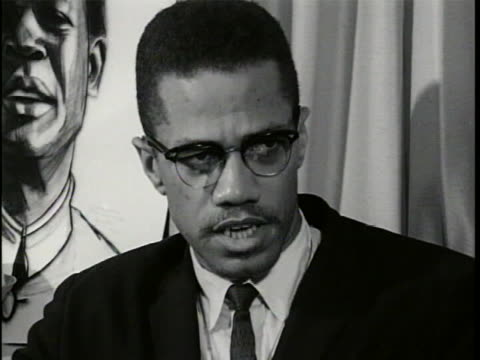 cu of malcolm x wearing a dark suit and sitting in front of a curtain with part of an illustration visible he says these words well one of the things... - leadership illustration stock videos & royalty-free footage