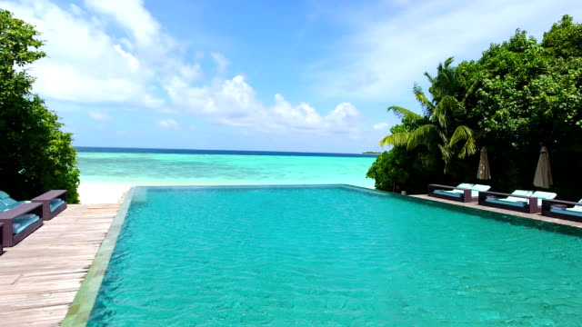 maldives, blue sky, turquoise sea, white sand and green palm trees. - villa stock videos & royalty-free footage