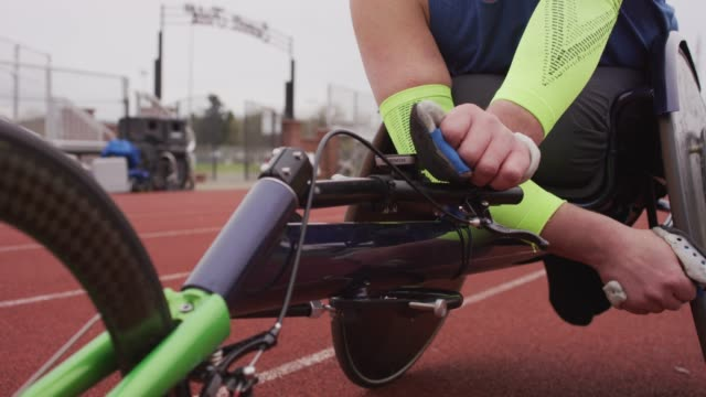 male adaptive athlete resting on his racing wheelchair - adaptive athlete stock videos and b-roll footage