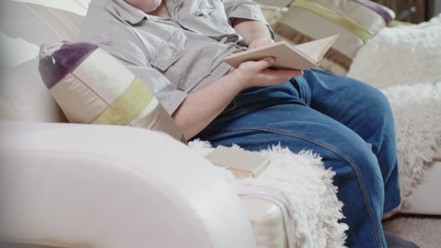 male adult with down syndrome reading book - reading glasses stock videos & royalty-free footage