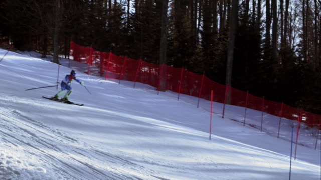 TS Male alpine skier skiing down the slope in a slalom race