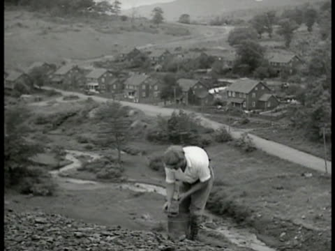 pennsylvania 'coal crackers' male amp female adults picking through clum dumps picking up coal from rock slate dump children w/ wagons moving heavy... - slate rock stock videos and b-roll footage