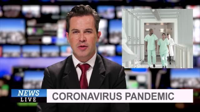 stockvideo's en b-roll-footage met ms male anchor at news desk presenting breaking news during coronavirus pandemic - reportage afbeelding