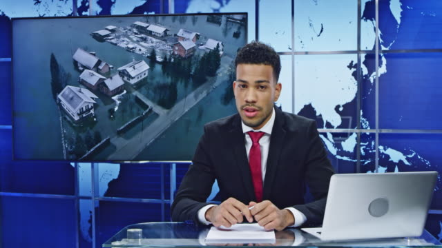 LD Male anchor presenting latest news on the flooding