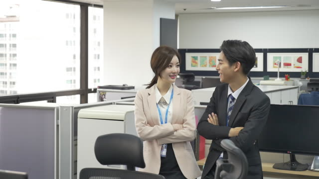 a male and a female employees at an office - east asian ethnicity stock videos & royalty-free footage