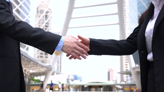 Male and Female Business Handshake in Slow Motion, Business Concept