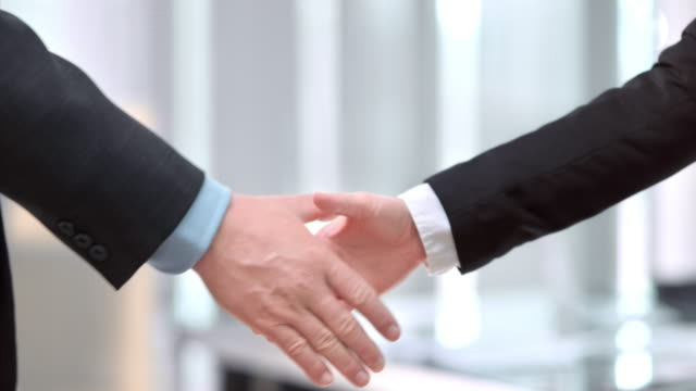 slo mo ds male and female business handshake - colleague stock videos & royalty-free footage