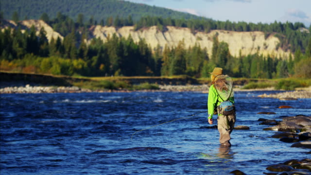 Male and female casting line freshwater fishing Canada