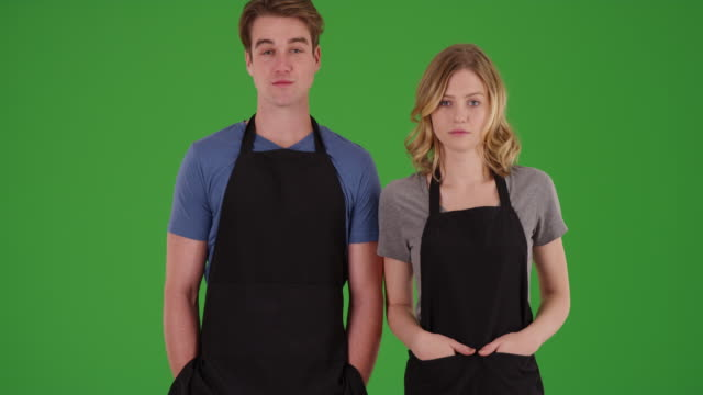 male and female chefs standing outdoors on green screen - apron stock videos & royalty-free footage