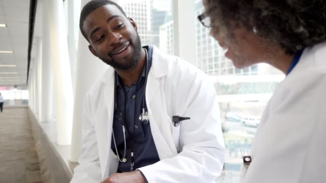 Male and female doctor discuss a patient's test results