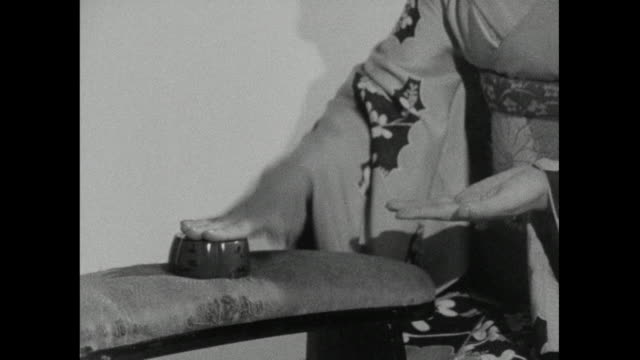 cu male and female geisha's hands playing games; 1966 - bbc archive stock-videos und b-roll-filmmaterial