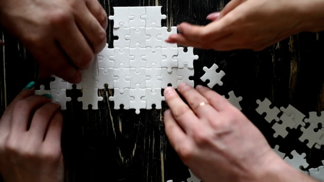 male and female hands  adds white puzzle